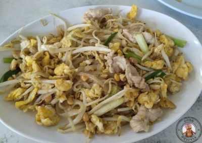 Fried noodles pork egg and peanuts
