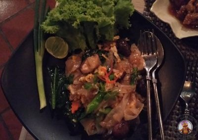 Ghuay Dtiaw Pad Nahmprig Pao - Wok-sautéed fresh rice noodles in roasted chilli jam with sea bass, prawns, or chicken