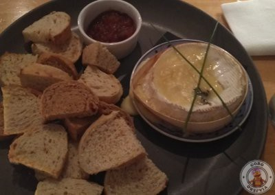 Boxed camembert baked in garlic, white wine _ herbs with mixed breads and house chutney